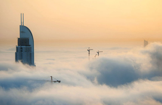 a-blaze-with-light-dubai-in-fog-sebastian-opitz-8