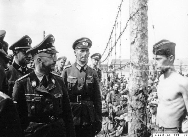 This undated photograph shows the Head of the Nazi German SS and Gestapo, Heinrich Himmler, as he inspects a German prisoner of war camp at an unknown location in the Soviet Union. (AP Photo)